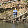 Smoking Sox soaks his feet in cold Kimberling Creek
